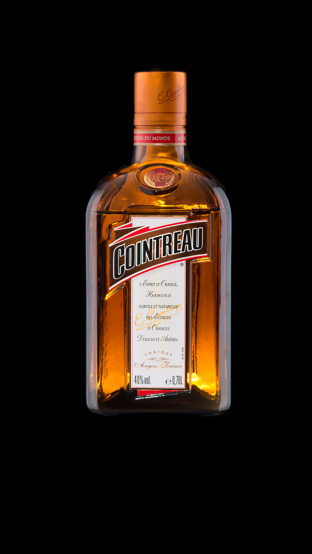 Cointreau bottle on black background food and beverage photography