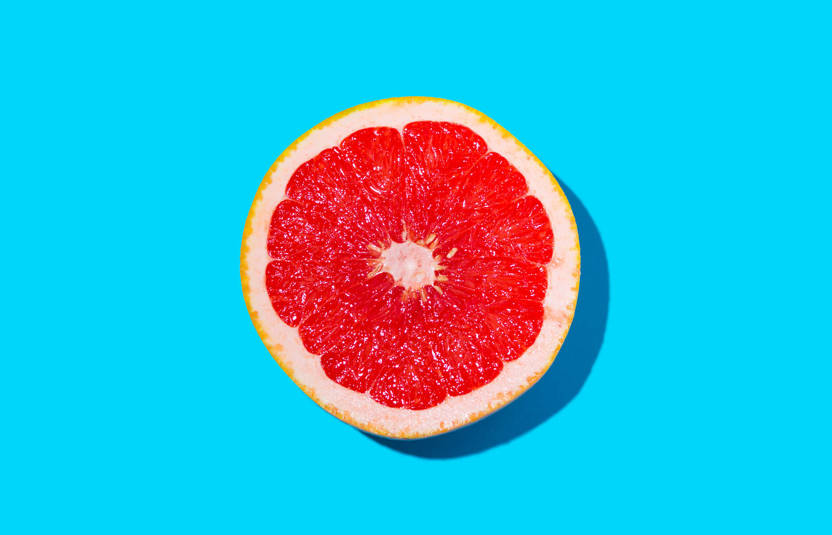 A slice of grapefruit food and beverage photography