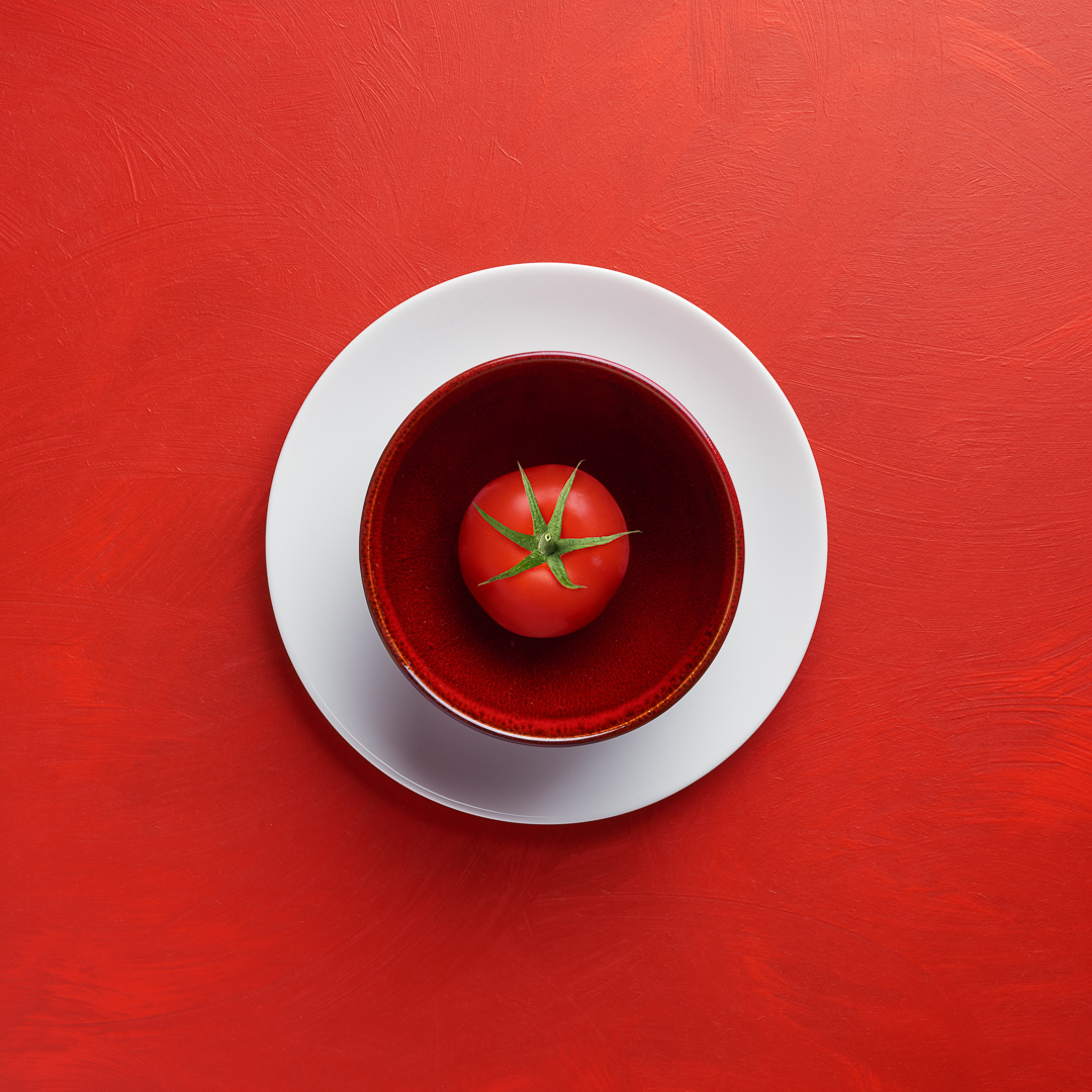 Tomato in a bowl on a plate - food photography